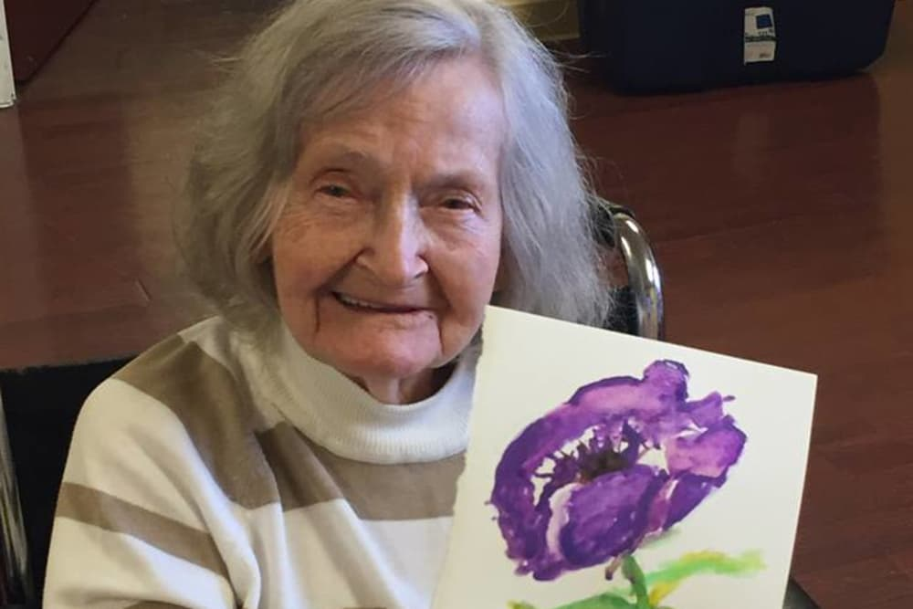 Female resident's floral painting at Prairie Lakes Health Campus in Noblesville, Indiana