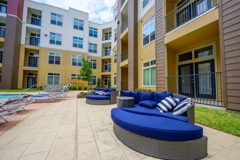 Outdoor seating area near pool at Aspire at 610 in Houston, Texas