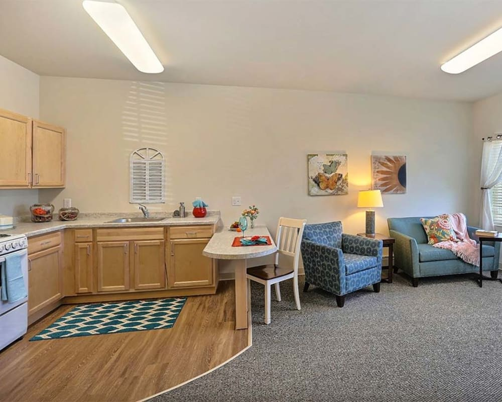 Resident apartment with a kitchen at Milestone Senior Living in Stoughton, Wisconsin.