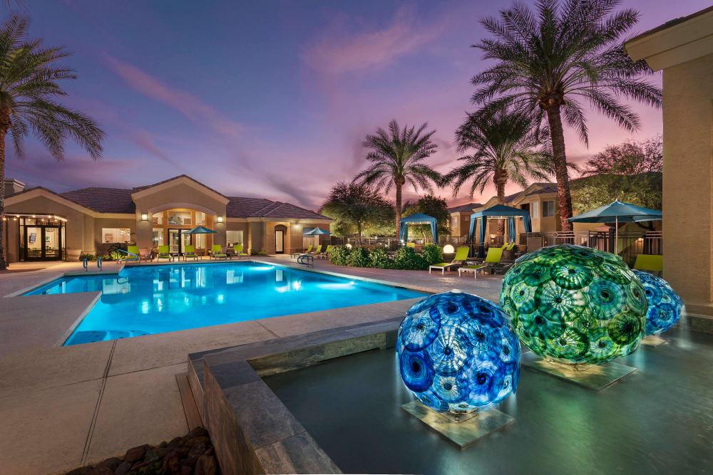 Beautiful swimming pool at dusk at Mira Santi in Chandler, Arizona