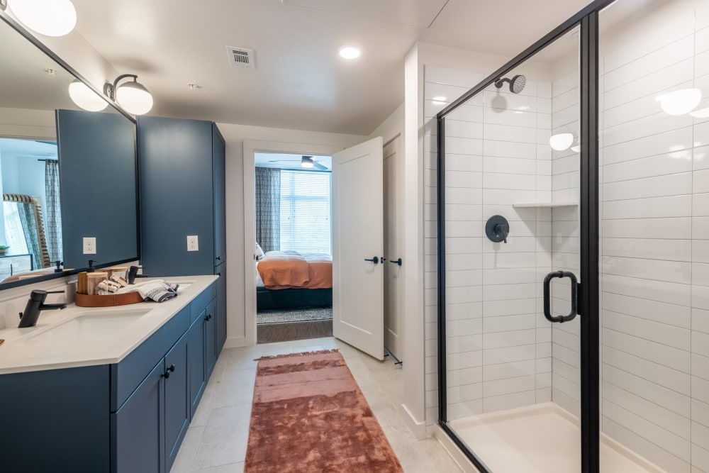 Gorgeous bathroom with spacious shower and lots of counter space at The Langford in Dallas, Texas