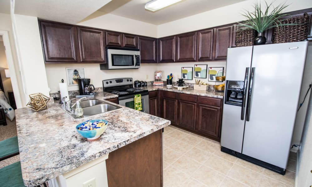 Spacious kitchen with granite counters at Tuscany Place in Lubbock, Texas