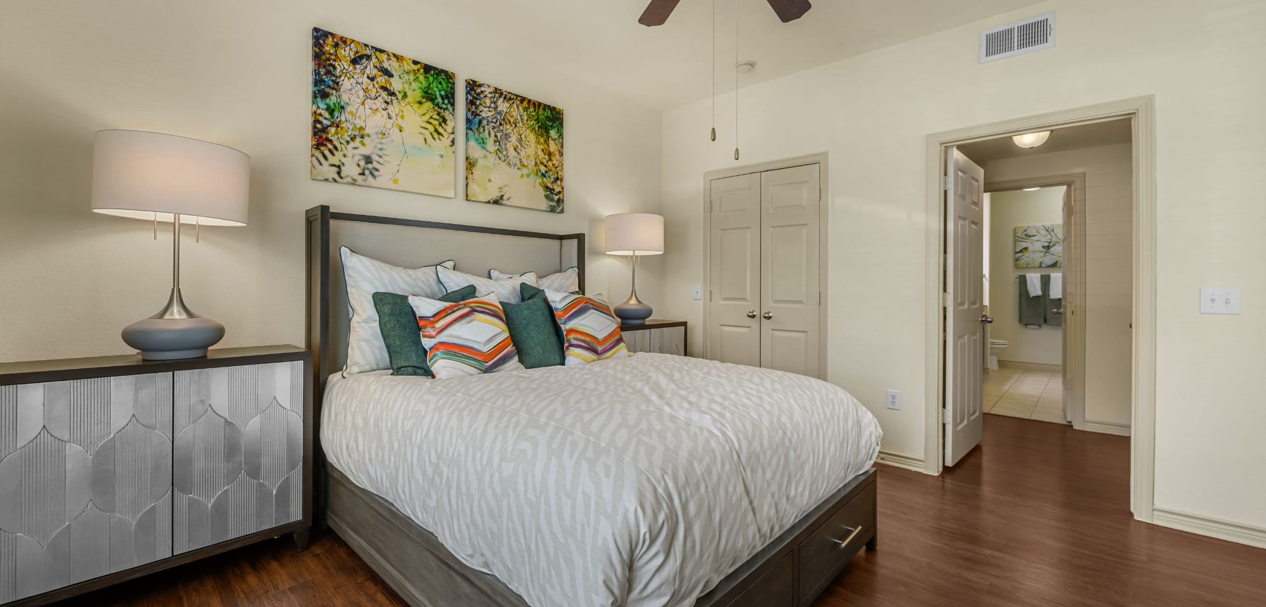 Bedroom with wood style floors and a ceiling fan at Marquis Lakeline Station in Austin, Texas