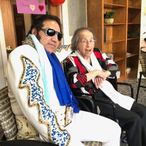 Resident Clara with Elvis Presley impersonator at The Atrium in Rockford, Illinois.