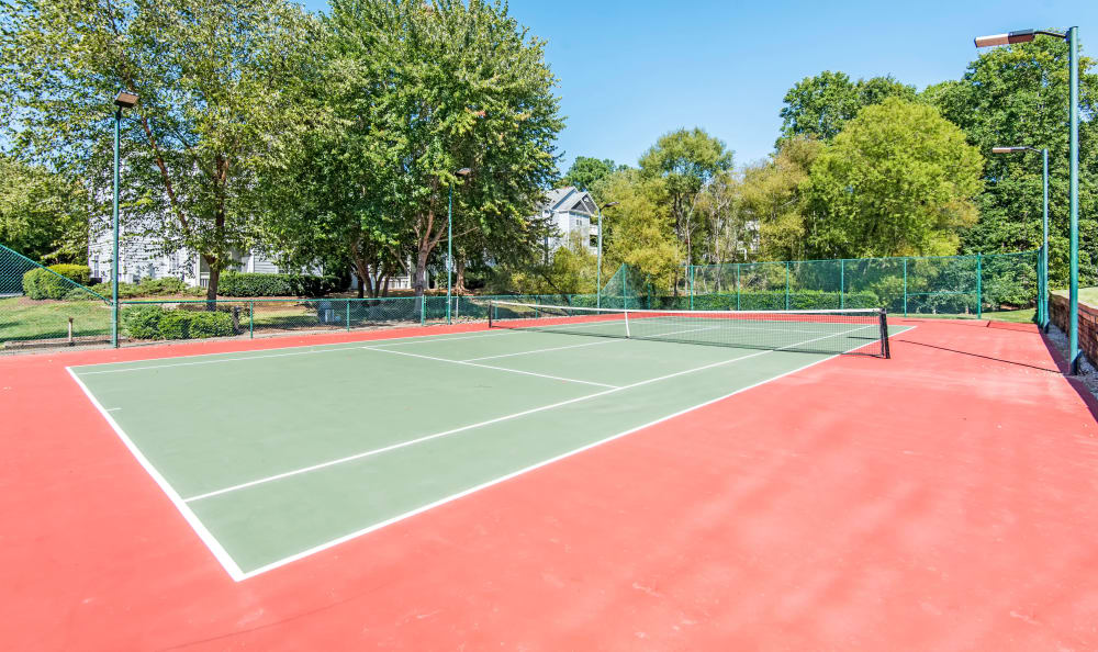 A tennis court is onsite for your enjoyment at The Village Apartments