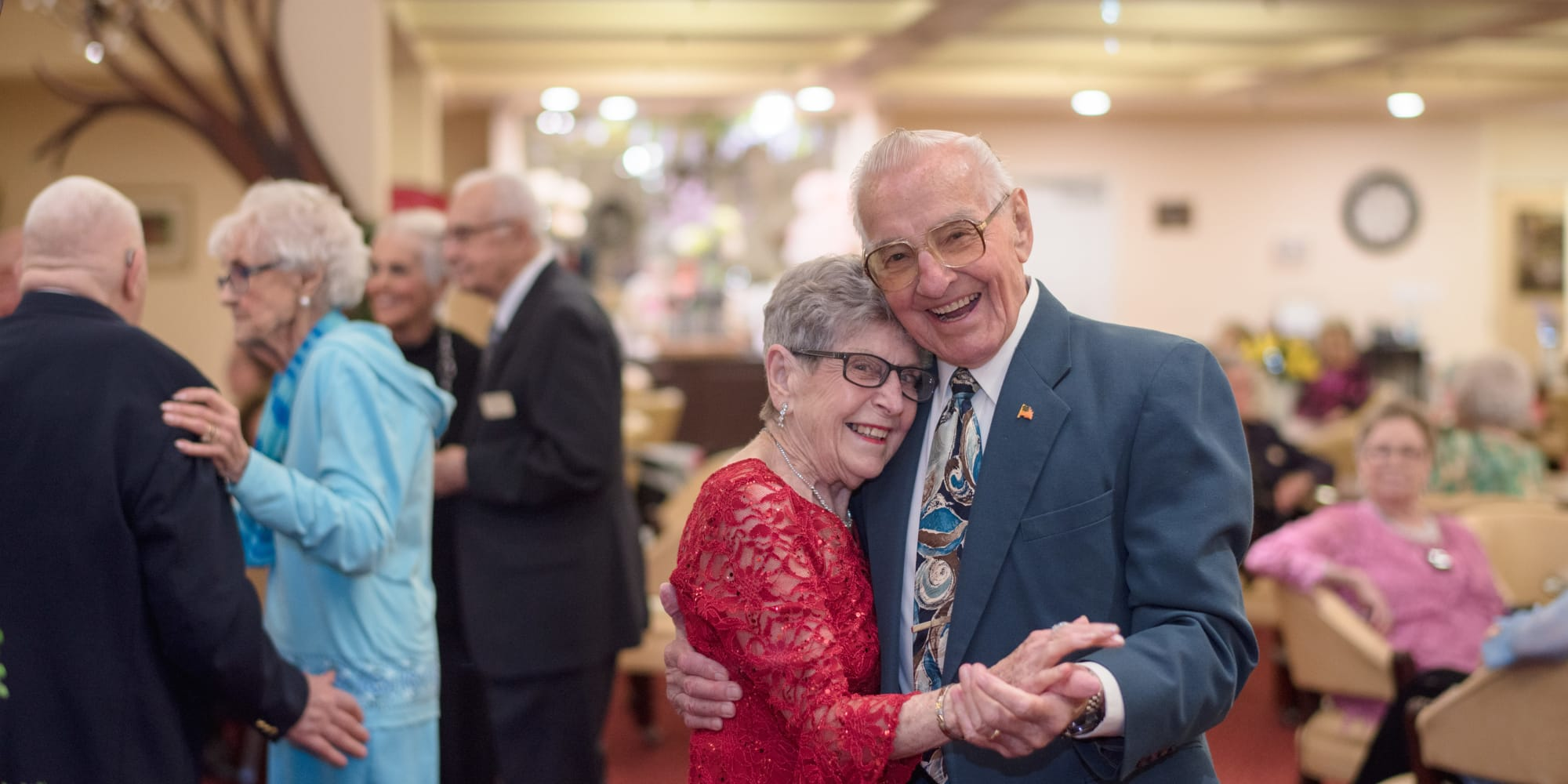 A happy couple dancing together at Steeplechase Retirement Residence in Oxford, Florida