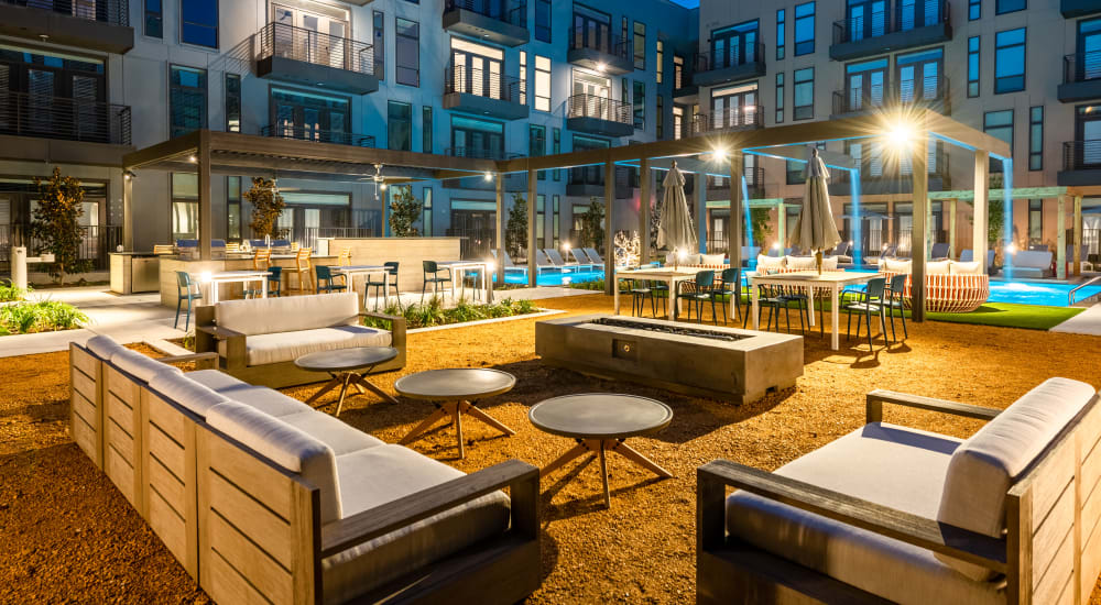 Resort style swimming pool with tons of seating for residents to relax in at The Langford in Dallas, Texas