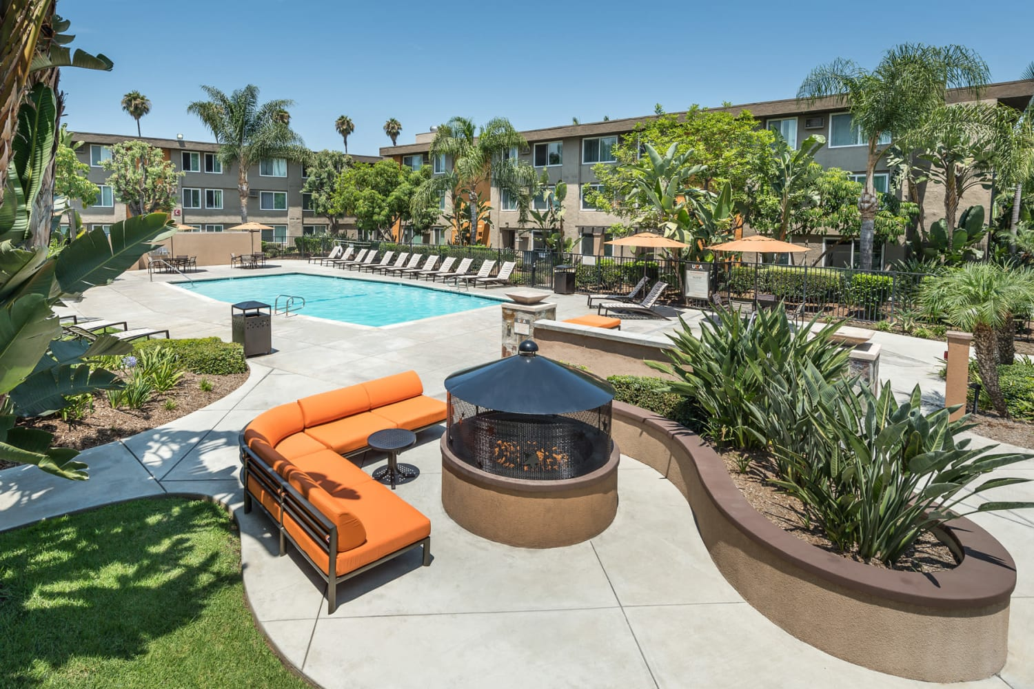 UCA Apartment Homes in Fullerton, California, offer a beautiful swimming pool and fire pit