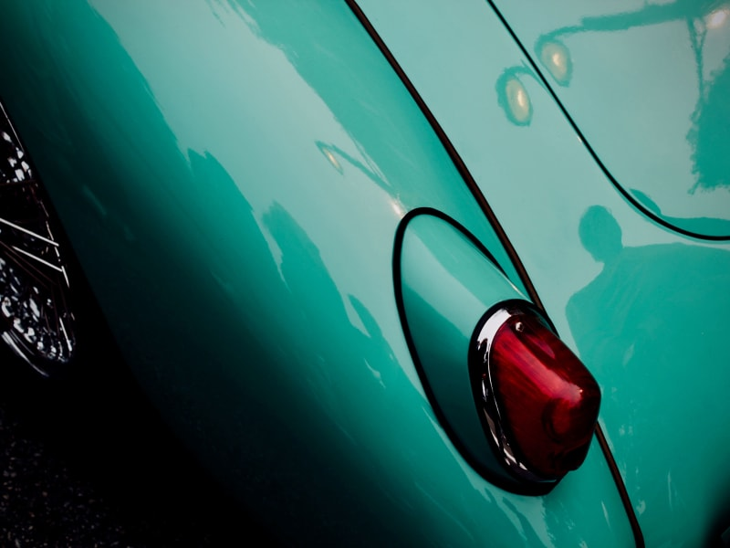 Detail photo of a classic car taillight, at Premier Car Storage in Miami, Florida