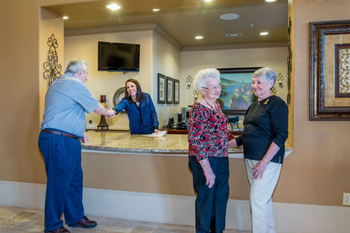 Residents at the front desk at Watercrest at Katy in Katy, Texas