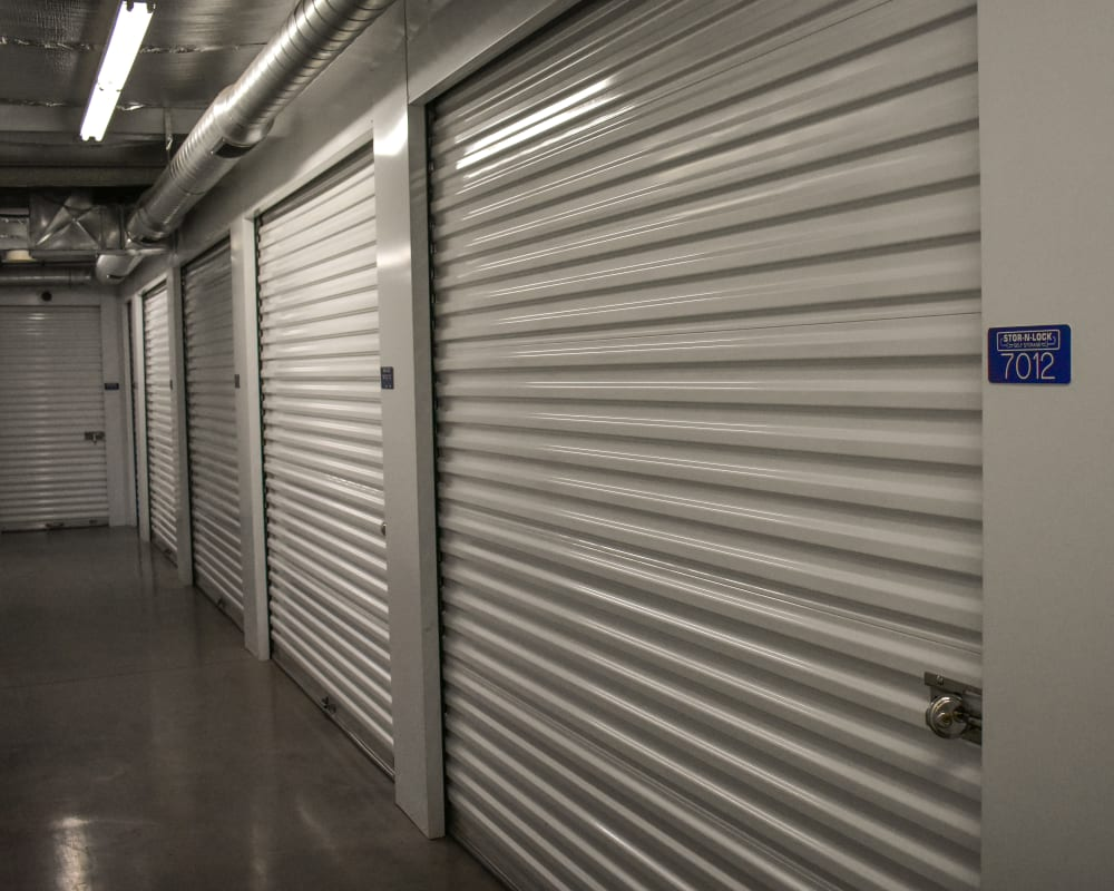 White doors on interior climate-controlled storage units at STOR-N-LOCK Self Storage in Hurricane, Utah