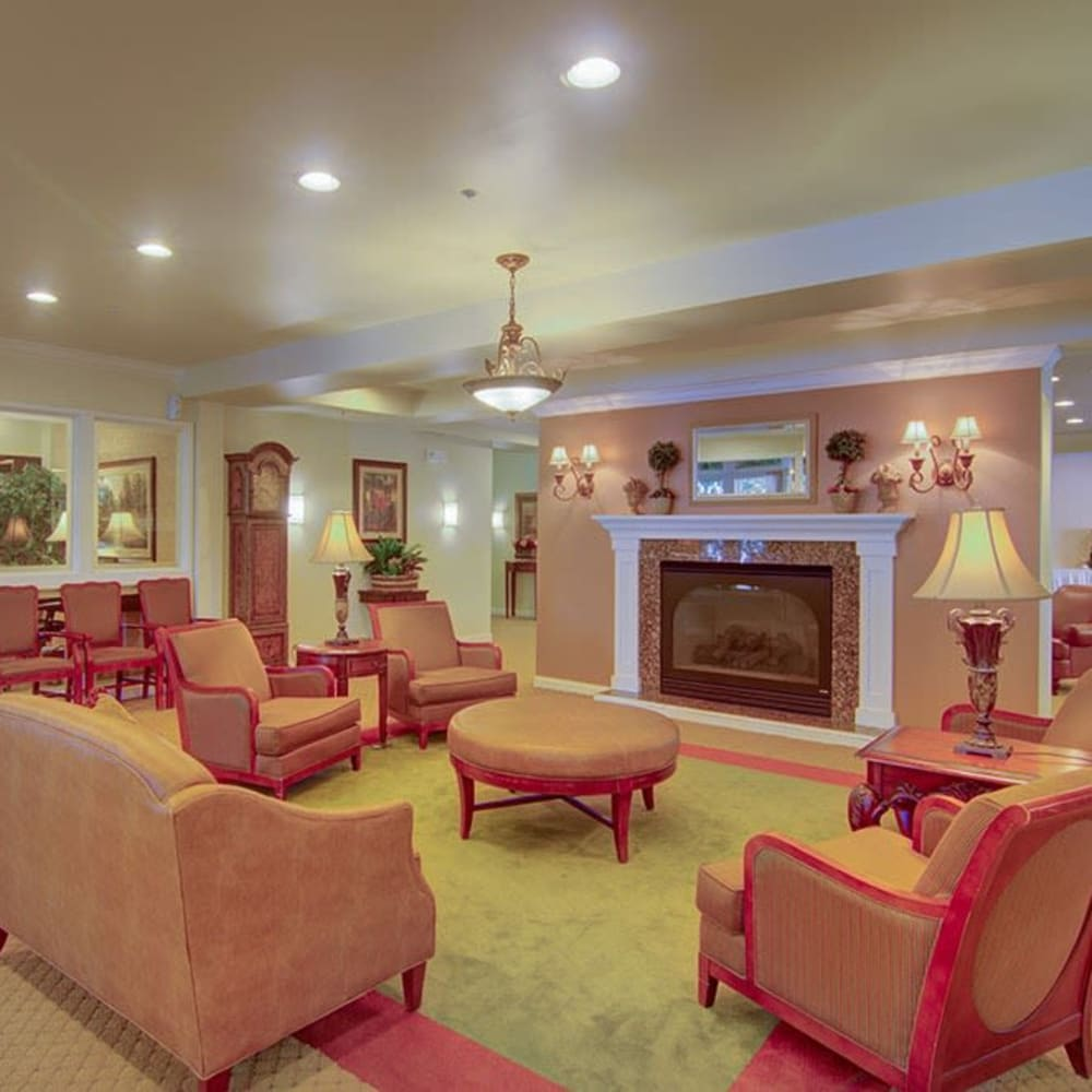 Community area with fireplace and elegant furniture at Randall Residence of McHenry in McHenry, Illinois