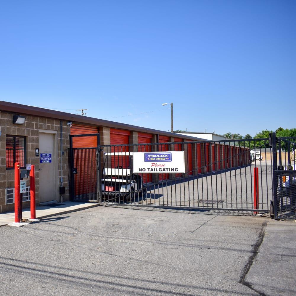 The secure front gate at STOR-N-LOCK Self Storage in Taylorsville, Utah