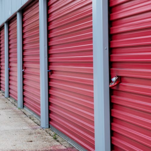 Close-up on red storage unit doors with a padlock at Red Dot Storage in Denham Springs, Louisiana