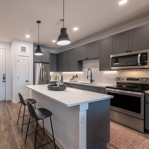 Spacious model home's kitchen with large island for tons of counter space at The Langford in Dallas, Texas