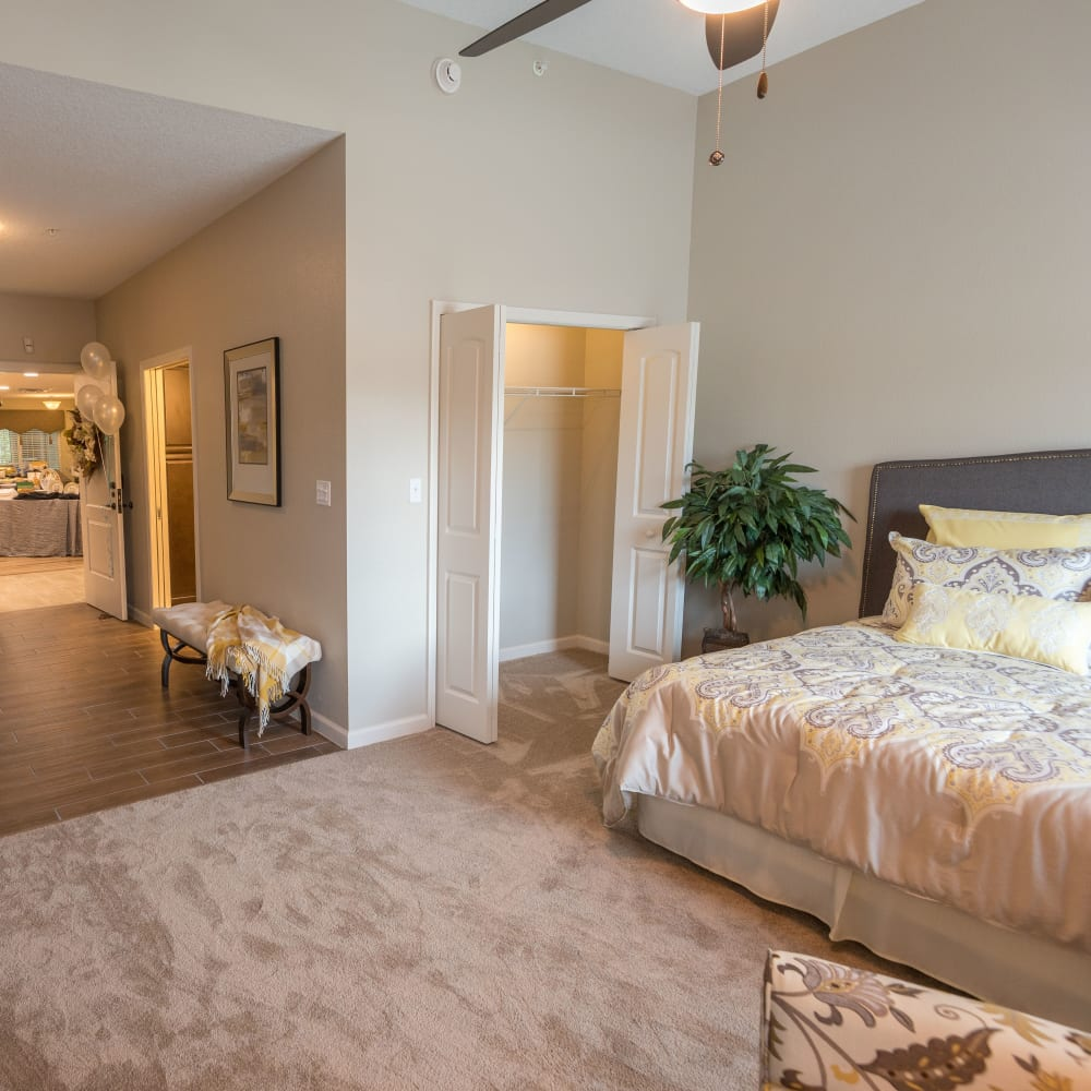 A spacious resident bedroom at Inspired Living Ocoee in Ocoee, Florida