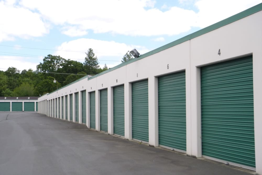 Storage units with green doors at America's Self Storage in Vancouver, Washington