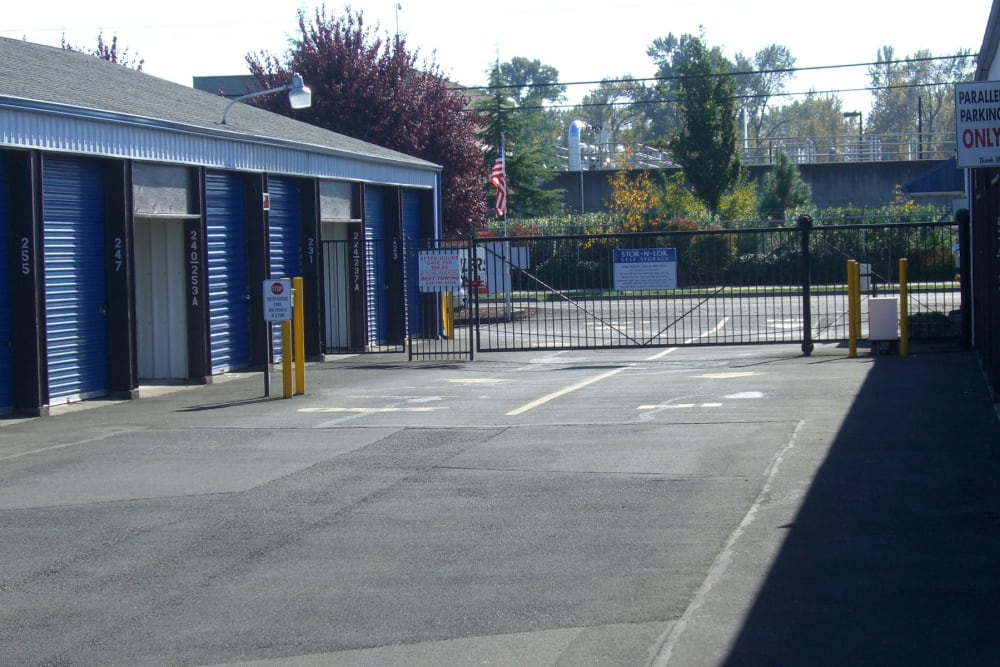 Wide driveway between storage units and the secure gate at Stor-N-Lok in Eugene, Oregon