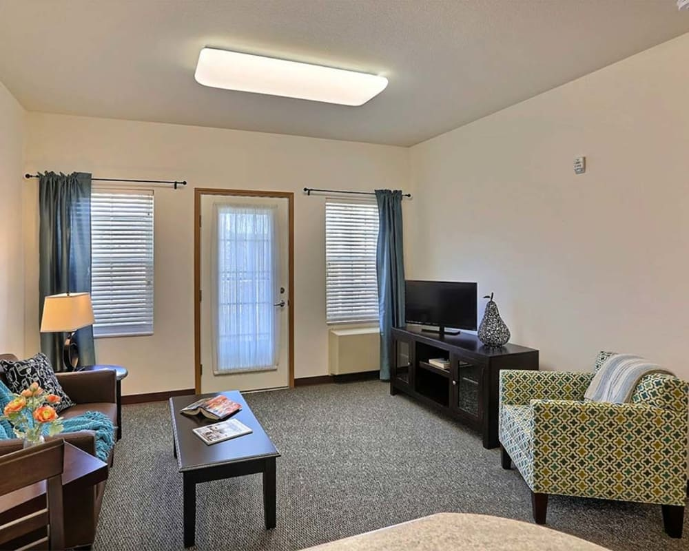 Resident apartment with large windows at Milestone Senior Living in Cross Plains, Wisconsin.