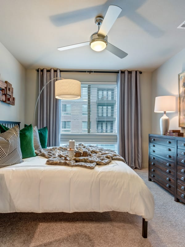 Master bedroom with a ceiling fan at Berkshire Auburn in Dallas, Texas