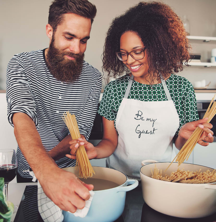 Couple cooking together at Oaks White Rock in Dallas, Texas