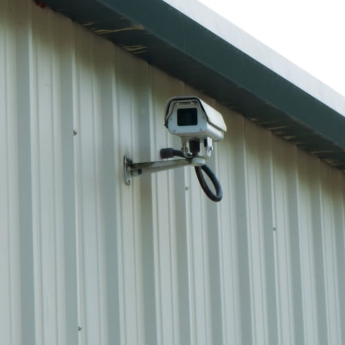Security camera mounted on an outside wall at Red Dot Storage in Columbia, Tennessee