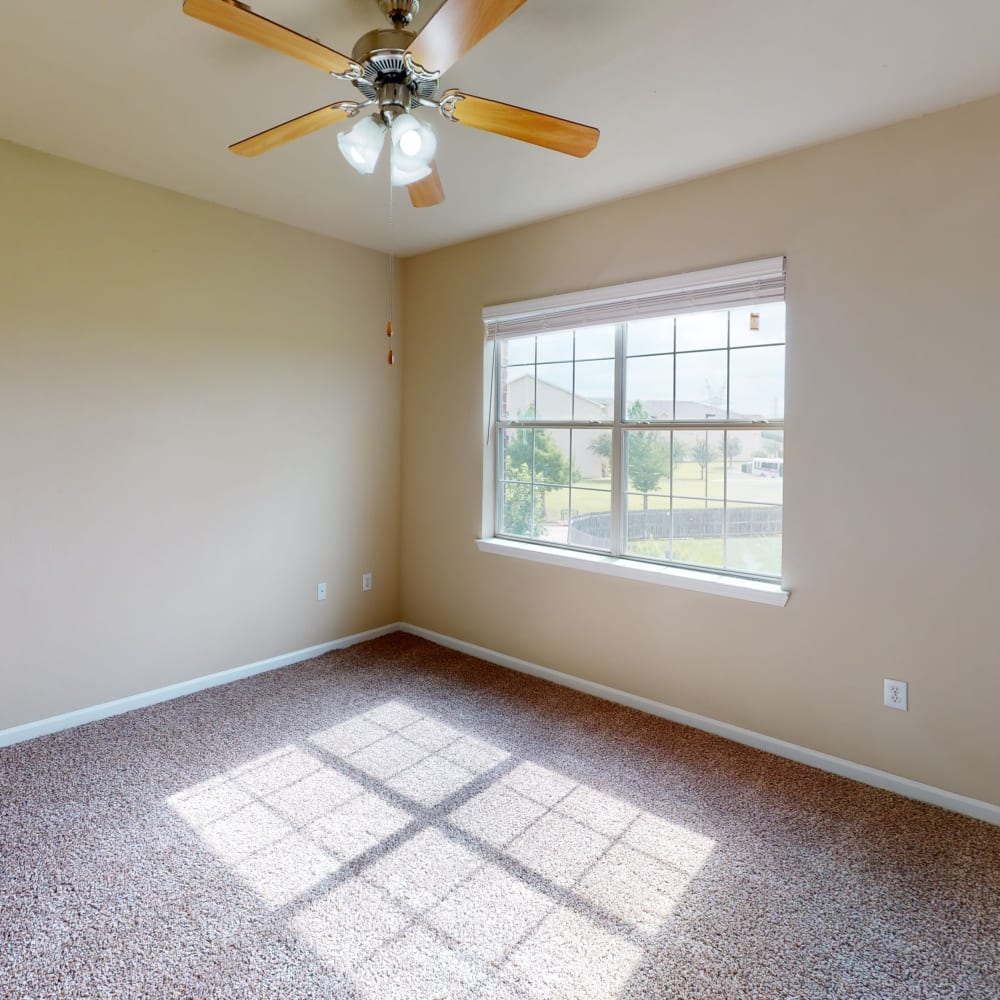Upper floor of a townhome with plush carpeting throughout at Oaks Estates of Coppell in Coppell, Texas