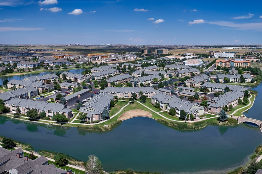Exterior view of Gateway Park Apartments from across the pond in Denver, CO
