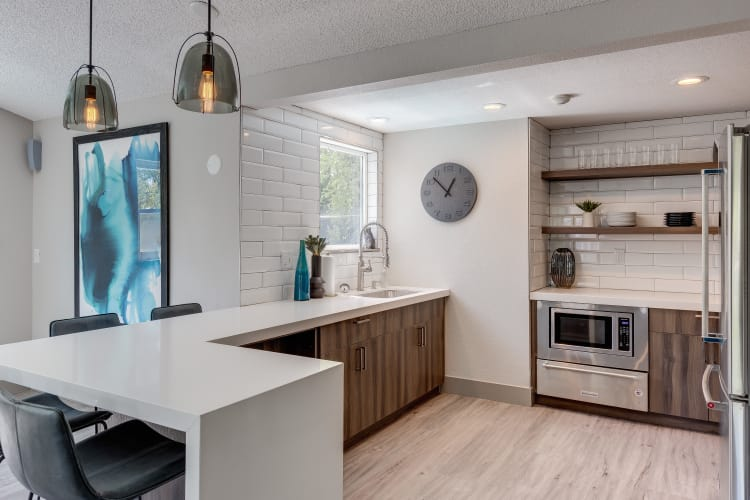 Lovely model kitchen with quartz countertops at Alaire Apartments in Renton, Washington