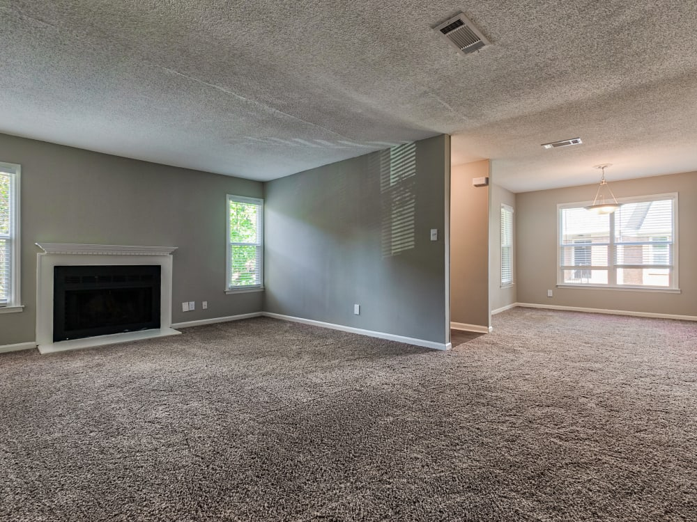 fireplace and living room at The Gatsby at Midtown Apartment Living in Montgomery, AL