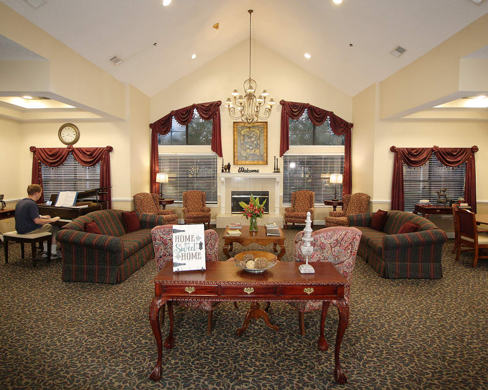 Spacious common area with fire place at West Fork Village in Irving, Texas