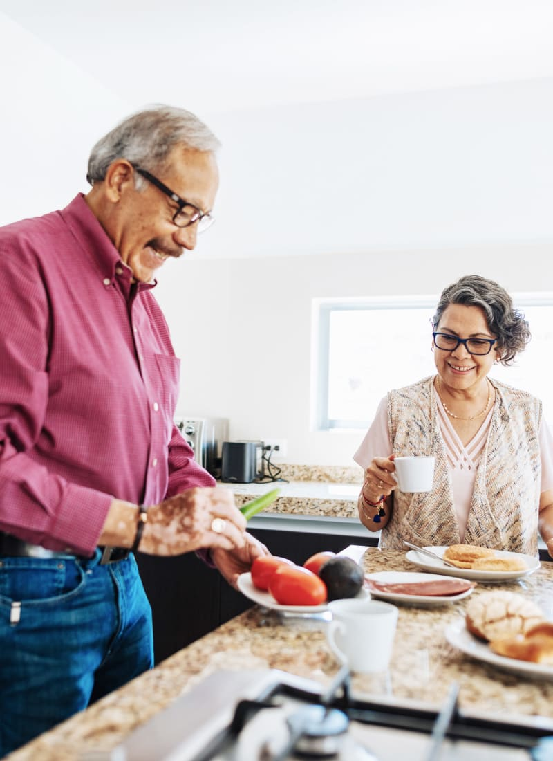 Older couple preparing breakfast at Alante at the Islands in Chandler, Arizona