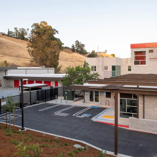 Outdoor storage units with bright doors at StorQuest Self Storage in Walnut Creek, California