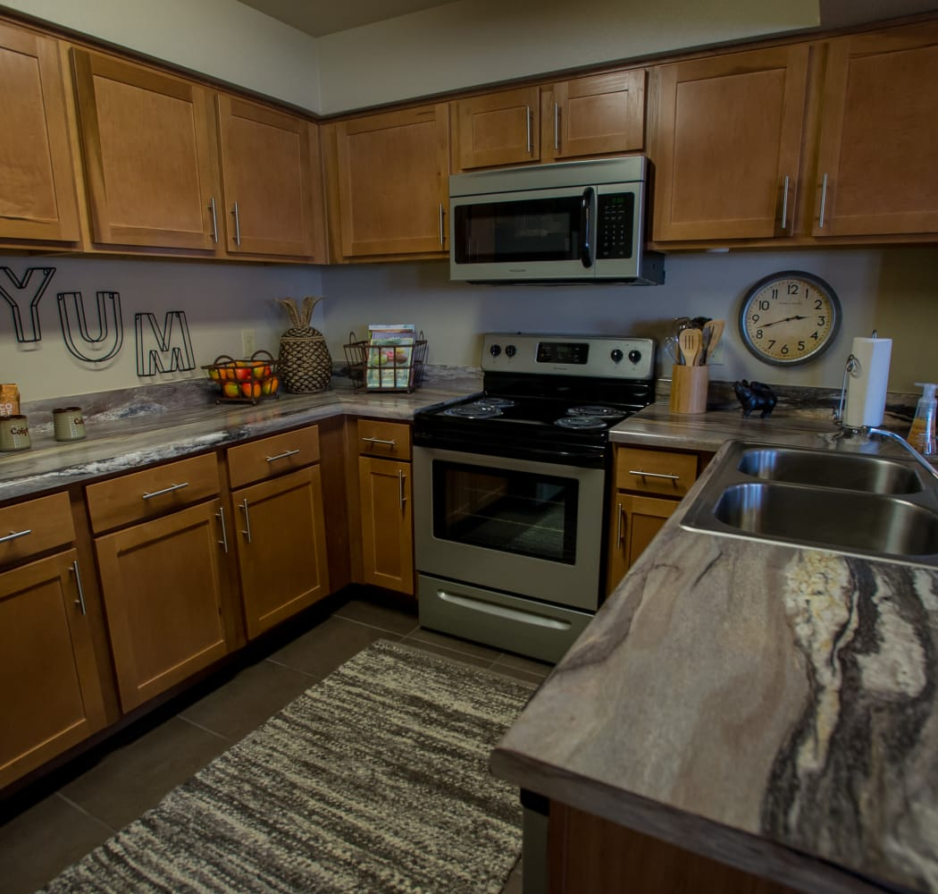 Kitchen with stainless steel appliances at Villas at Canyon Ranch in Yukon, Oklahoma