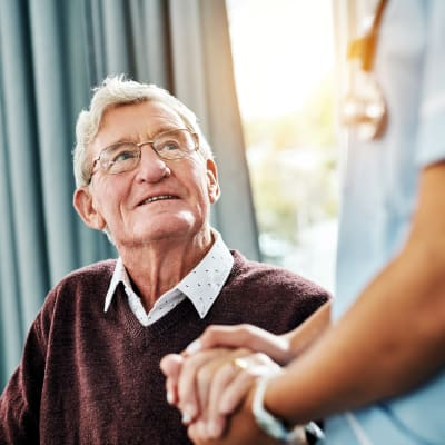 A resident talking to a staff member at Aurora on France in Edina, Minnesota.