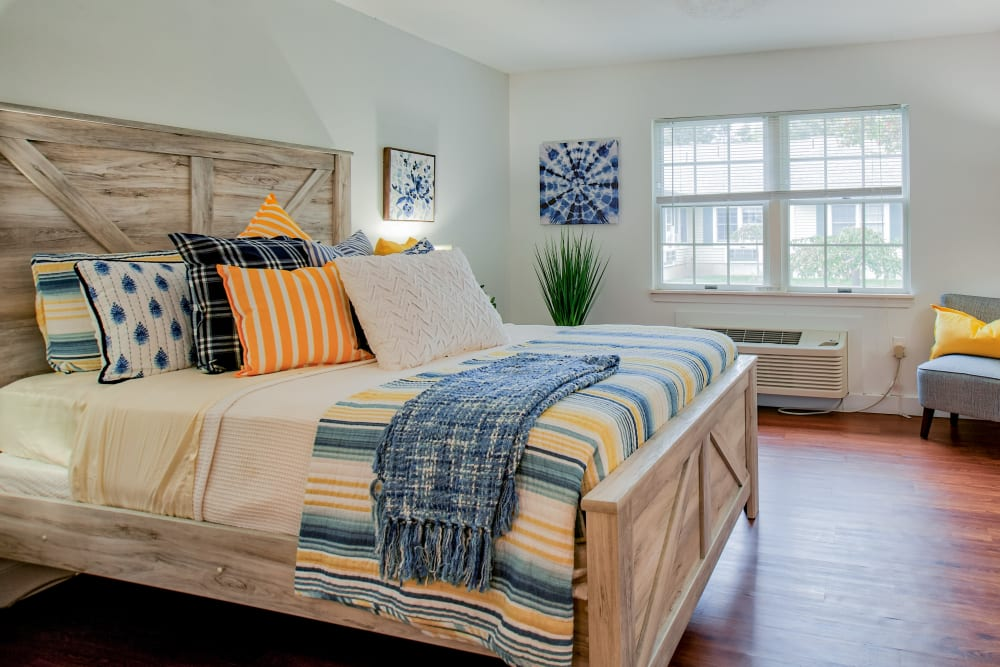 Room with one beds and a dresser in a large bedroom at Wood Haven in Tewksbury, Massachusetts