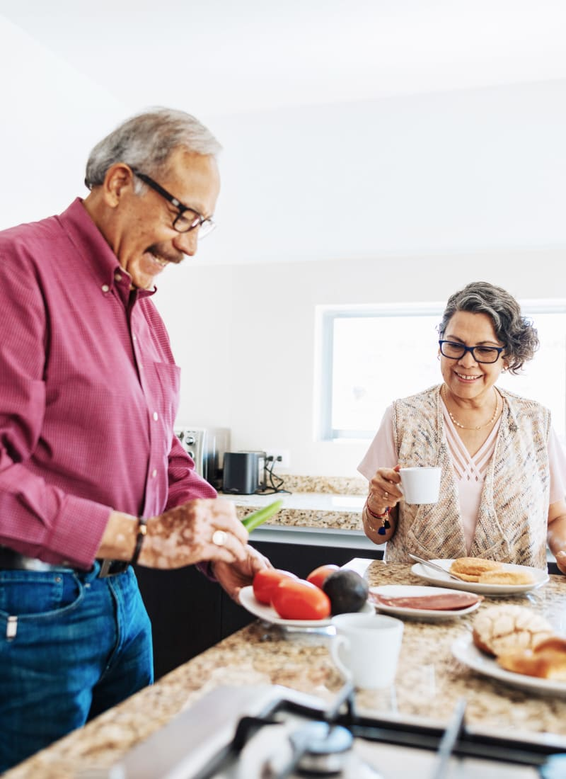 Residents couple preparing breakfast at Marquis at Great Hills in Austin, Texas