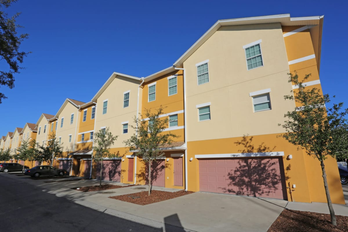 The yellow exterior of Town Park Villas in Tampa, Florida