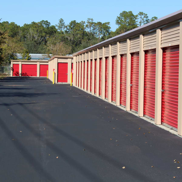 Exterior units with red doors at StorQuest Self Storage in Gainesville, Florida