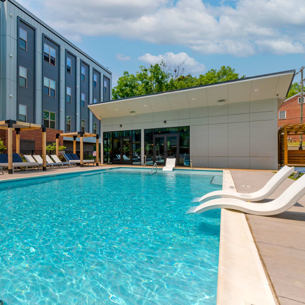 Community pool and lounge at UNCOMMON Raleigh in Raleigh, North Carolina