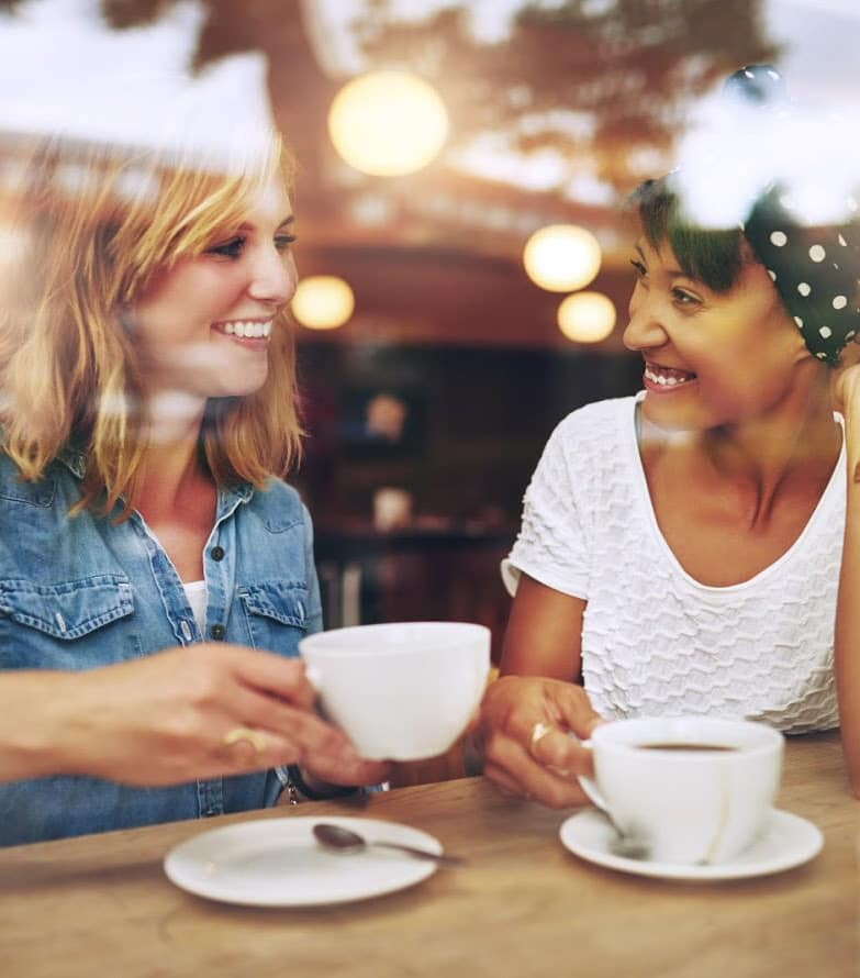 Friends having coffee together at Shadow Oaks Apartment Homes in Cupertino, California