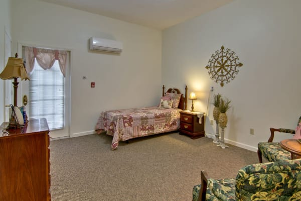 Assisted living apartment bedroom at Greenbrier Meadows in Martin, Tennessee