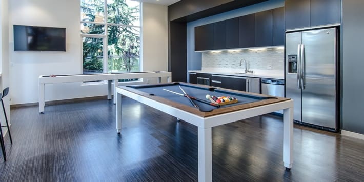 Game room and kitchen in Cielo's clubhouse in Seattle, Washington