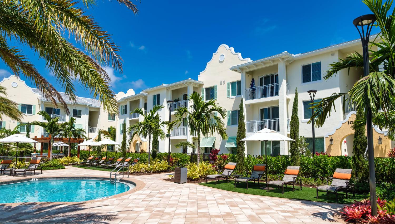 Resort-style pool and lounge seating at Town Lantana in Lantana, Florida