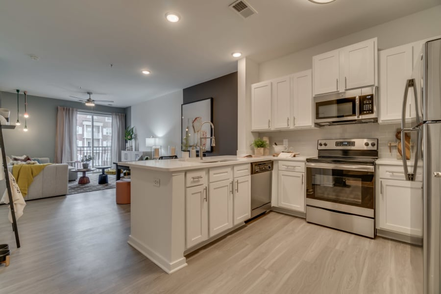 Very cozy and modern kitchen in a model home at The Flats at West Broad Village in Glen Allen, Virginia