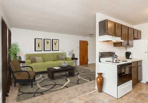 Bright, spacious living room at Parkway Manor Apartments in Rochester, New York