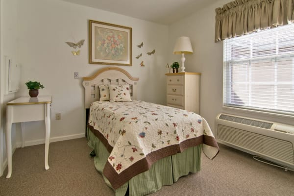 Assisted living apartment bedroom at Ravenwood Senior Living in Springfield, Missouri