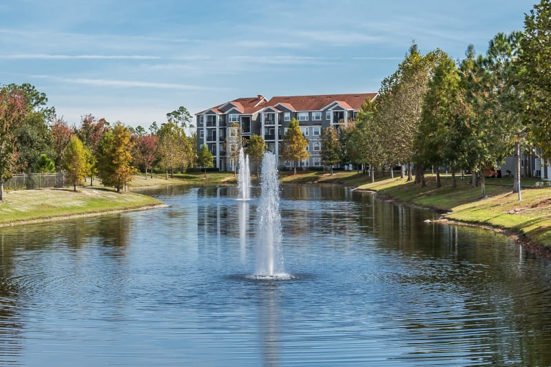 Exterior complex view with fountain on the water at The Aspect in Kissimmee, Florida