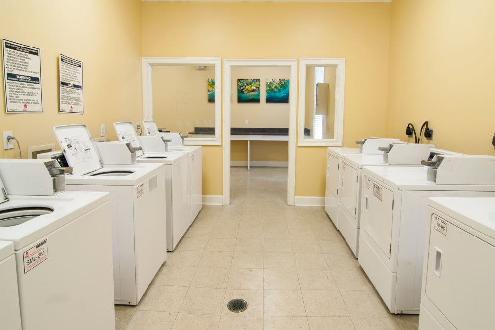 Laundry room at Amber Chase Apartment Homes in McDonough, Georgia