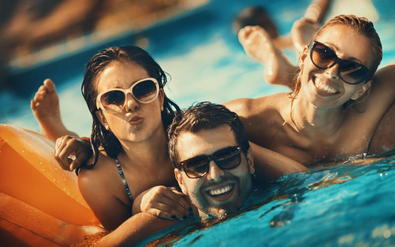 Enjoy the swimming pool at Woodcreek Apartments in Huntsville, Texas